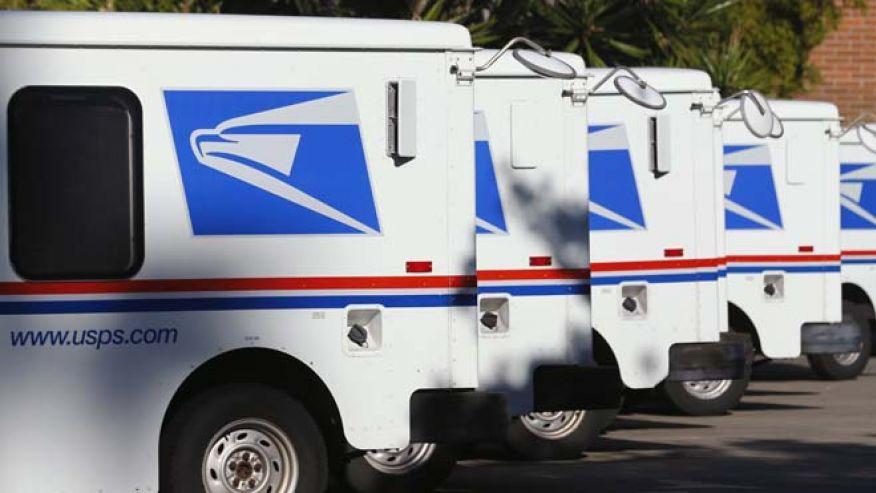 US Postal Service mail trucks_reuters_660