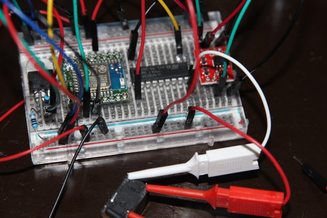 blueIOT and a Darlington driver running the relay (black on bottom), optocoupler (red) running Arduino code on the ATmega328P.