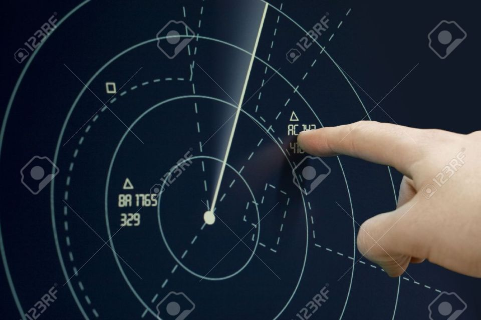 11943716-Air-traffic-controller-point-to-plane-on-radar-sonar-Air-Traffic-Control-Tower-Stock-Photo