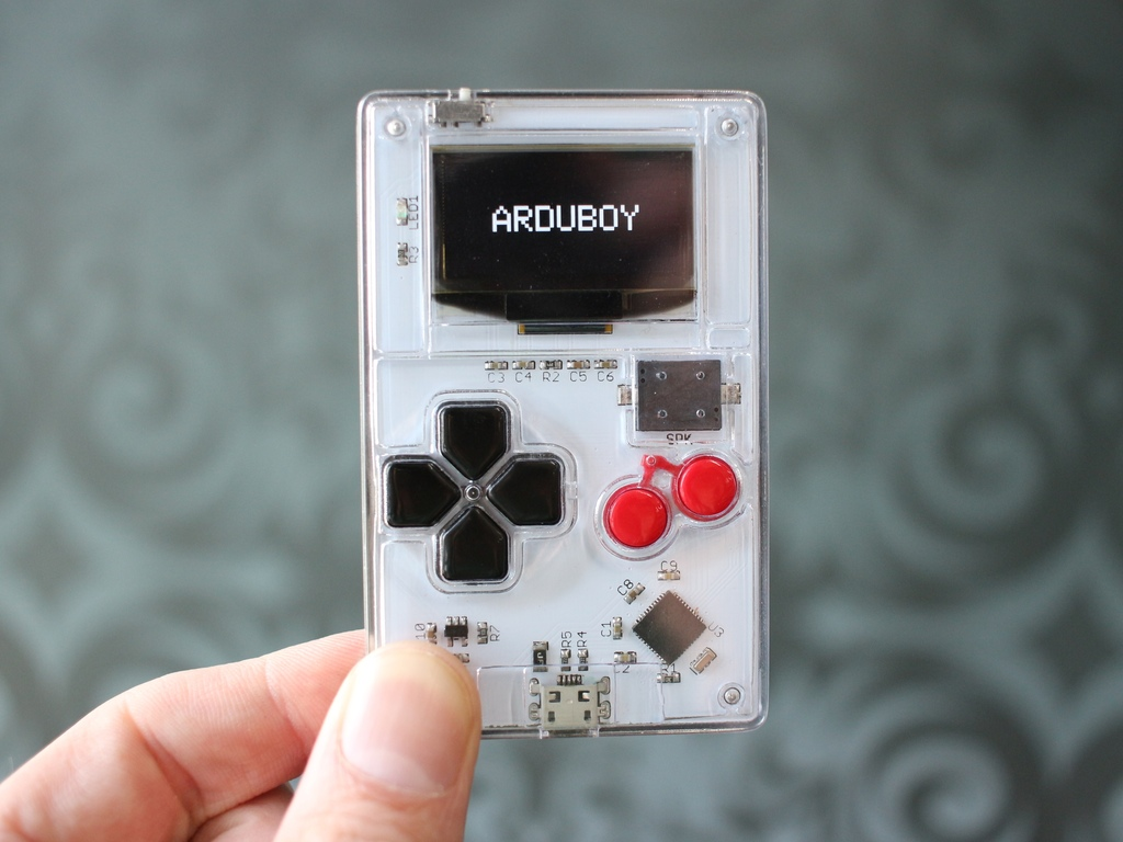 Arduboy is a video game playing business card atmel bits pieces photo original 2 colourmoves
