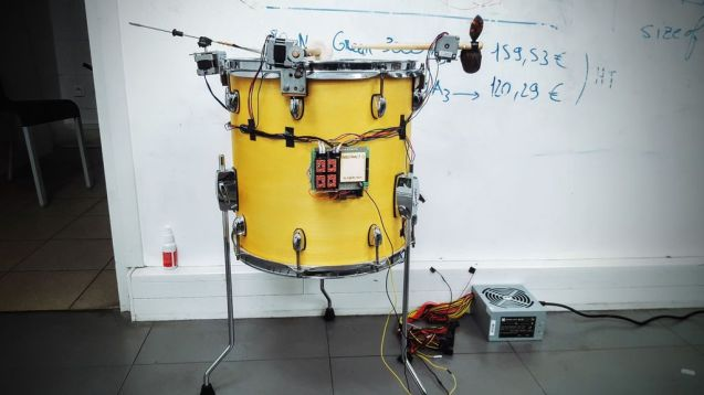 Maker builds an abstract clock out of a drumset