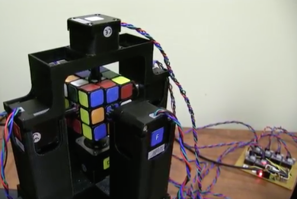 Watch a robot solve a Rubik's Cube in one second